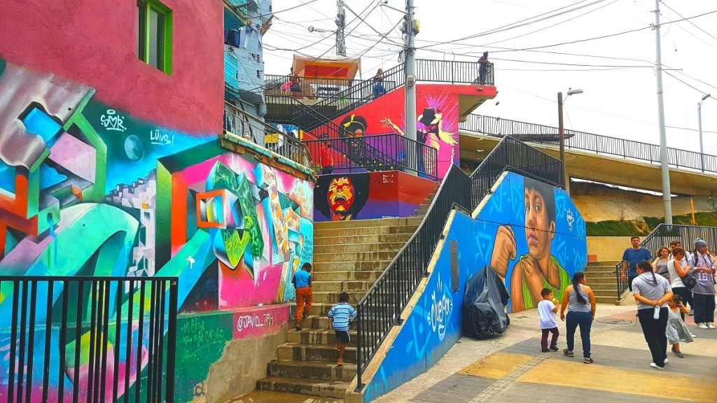 Comuna 13 is overcoming its difficult past and now attracts tourists from all around the world who come to view the amazing graffiti