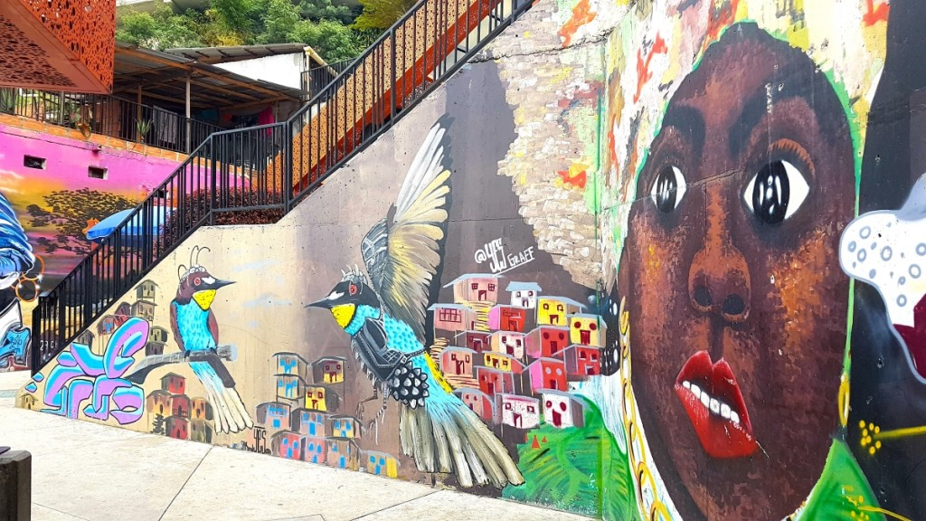 This powerful mural by @YesGraff shows the impact of the violence on the local community