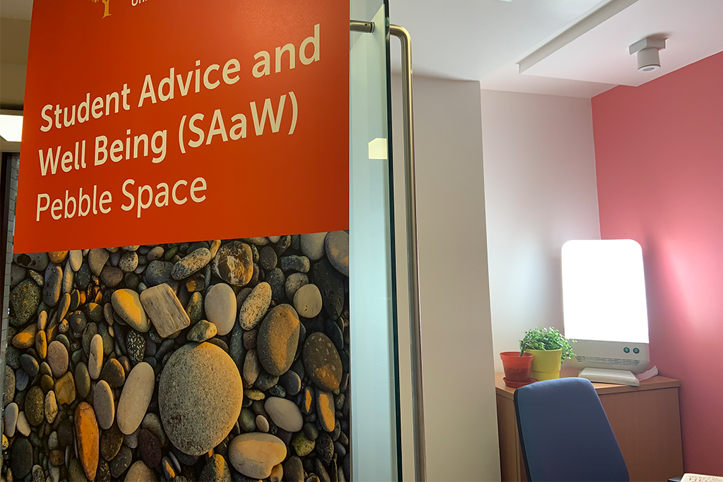 student advice and wellbeing sad lamp