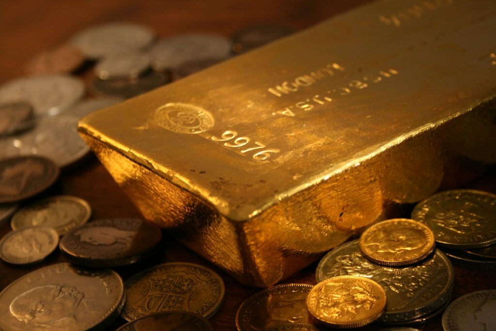 gold bar and coins