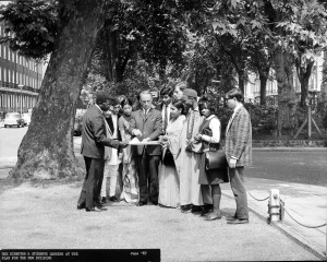 Professor Sir Cyril Philips, SOAS Director, 1967 and students examine the plans for the new building
