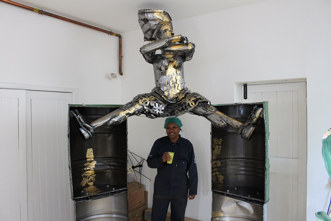 Sokari providing some scale under her piece 'All That Glitters'