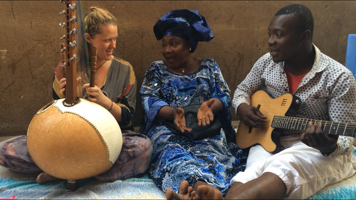 L to R: Daisy Burt, SOAS 3rd year music student (on kora), and recipient of 'Roots' fieldwork award, studies Mande music with Hawa Kasse Mady Diabaté, leading Malian singer, and Lafia Koné (on guitar) in January 2017 in Bamako, Mali.