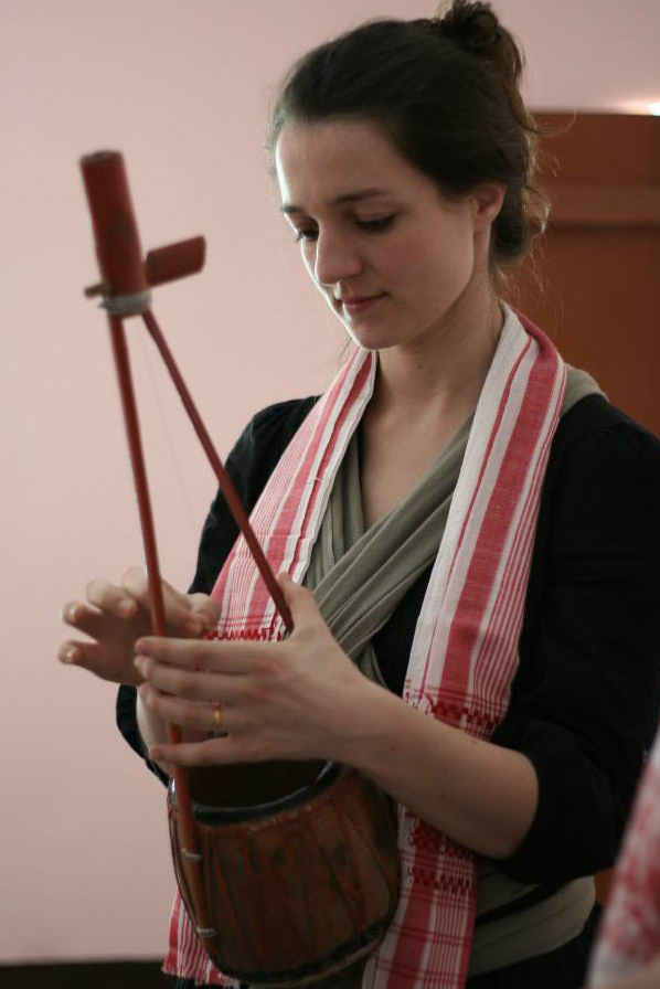 Georgie Pope playing a musical instrument