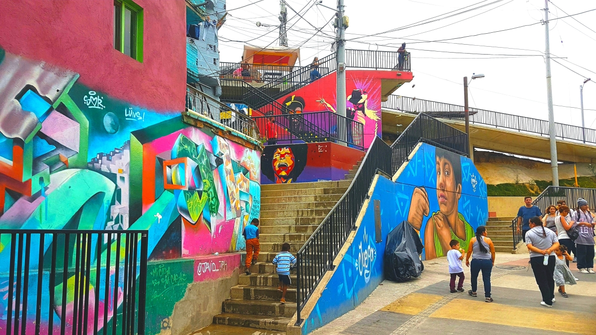 Development Studies - Comuna 13 is overcoming its difficult past and now attracts tourists from all around the world who come to view the amazing graffiti
