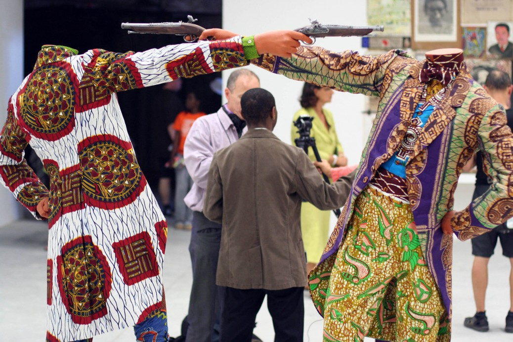 Professor Olu Oguibe discussing Yinka Shonibare's work at the Venice Biennale, Arsenale