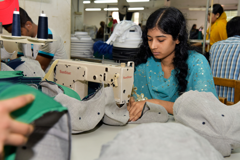 Bangladeshi garments workers work inside a factory at Ashulia, in Dhaka, Bangladesh on December 26, 2016.