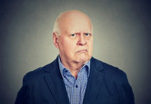 Portrait of an angry, grumpy senior business man, decolonisation