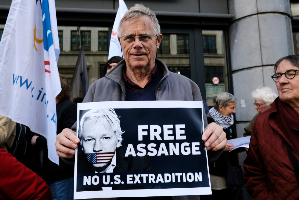 Supporters of WikiLeaks founder Julian Assange rally outside of British Embassy, Belgium, 2015.