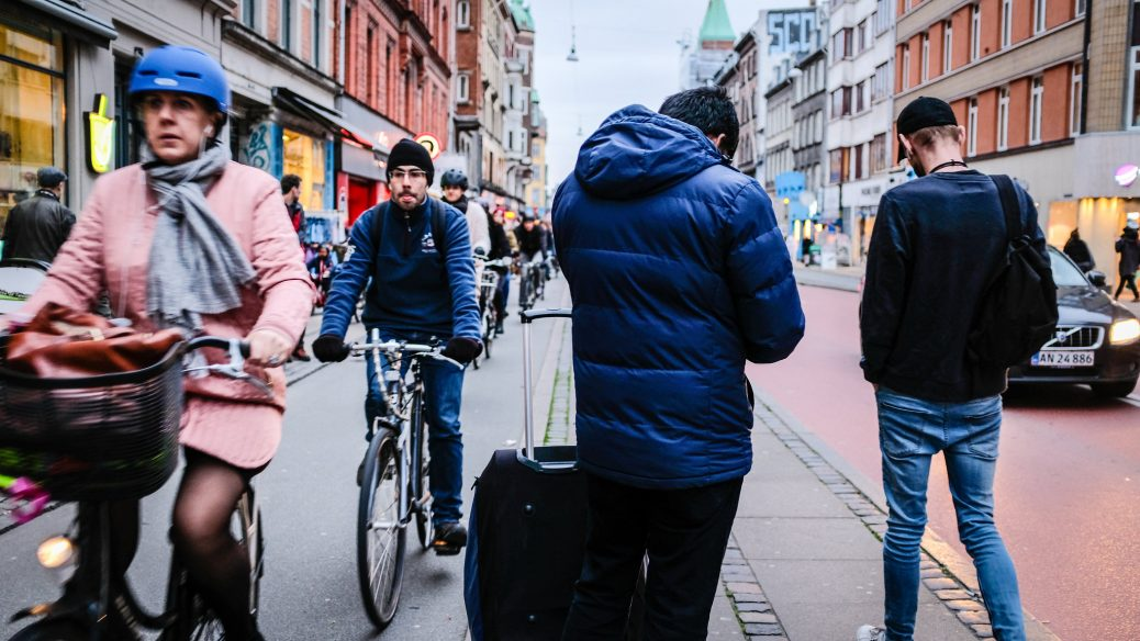 Migration illustrated by pedestrians and cyclists in street Klaus Berdiin Jensen