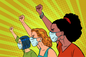 Three woman wearing masks in the Covid-19 pandemic protesting