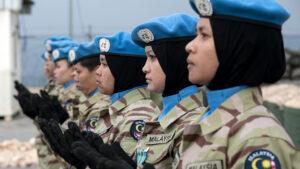 An image of five women from the Malaysian army in army attire and holding guns