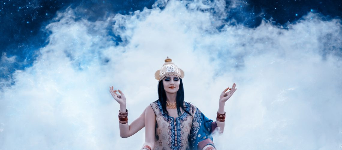 beautiful east exterior girl sitting in the smoke depicting eastern deity, indian, shiva, fashion creative color toning