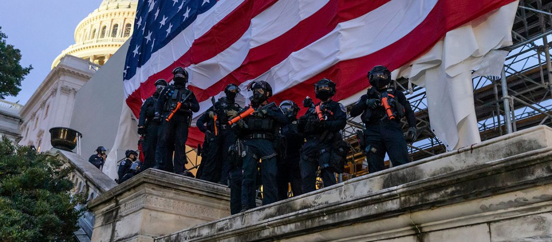 Police in front of the Capitol Building as Trump supporters storm the building