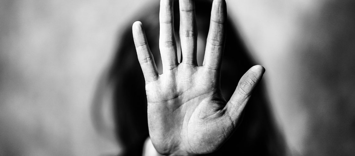 Image of a woman stretching out her hand, palm open, to stop an abuser. Blog about domestic violence.