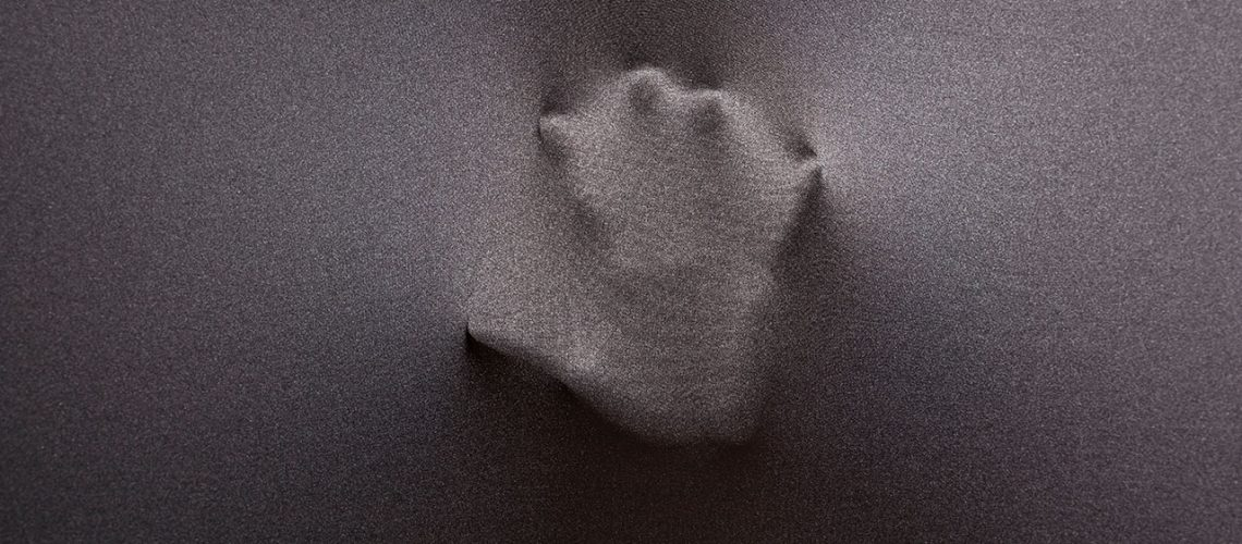 Handprint on fabric - symbolic of mark left by heroes