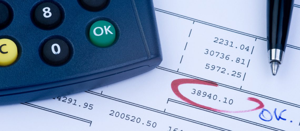 (c) Philippe Put/Flickr image to illustrate finance and risk management i.e. a page of accounts and calculator