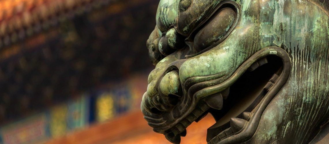This bronze imperial guardian lion is one of a pair which guard the Gate of Supreme Harmony - the second major gate in the south of the Forbidden City in Beijing, China.