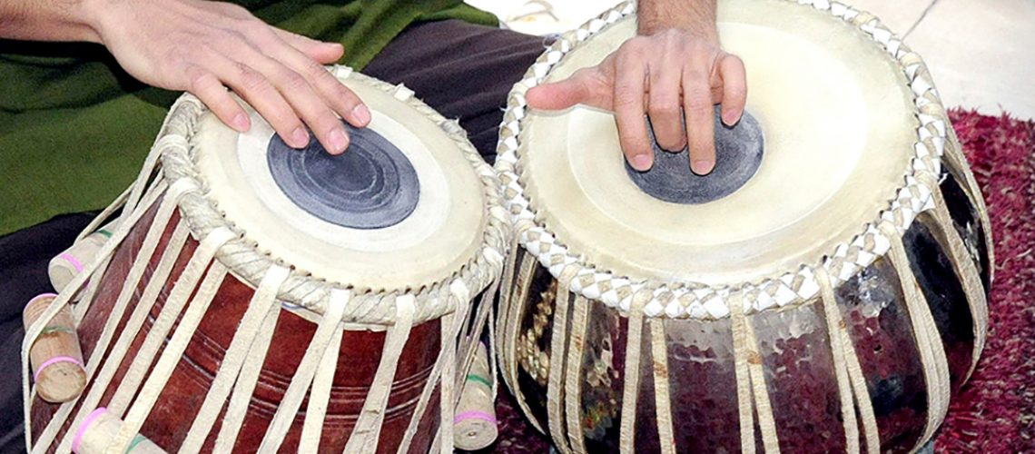 Join a drumming workshop at WOMAD.