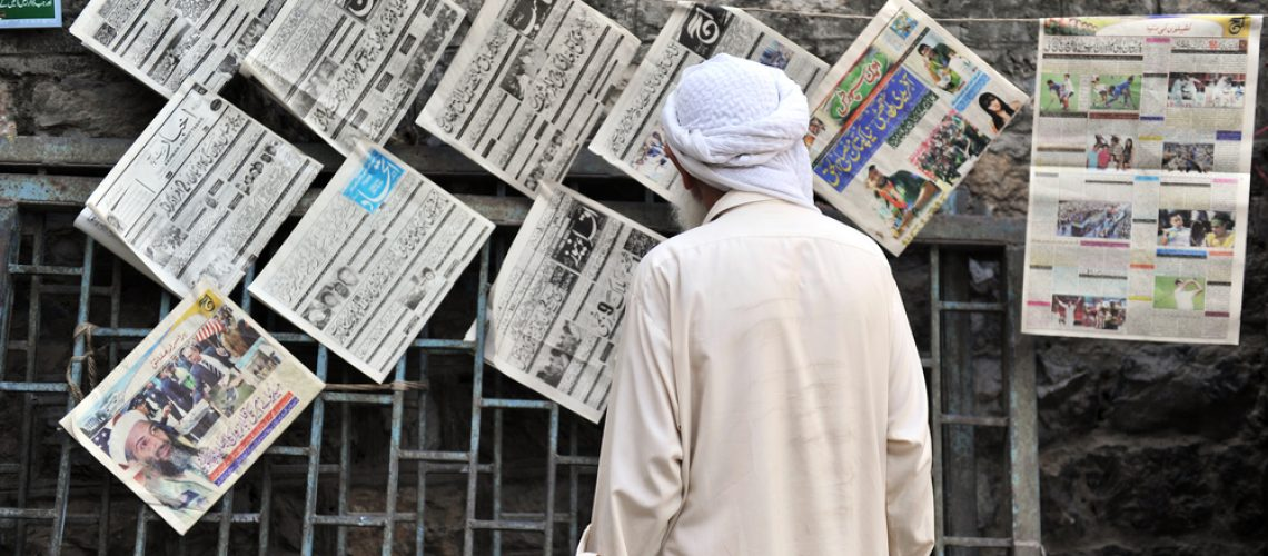 Pakistani man reading newspapers and daily life on May 15, 2011 in Abbottabad, Pakistan