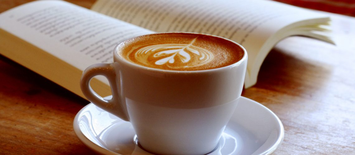 Cup,Of,Latte,Or,Cappuccino,Coffee,With,A,Book,In