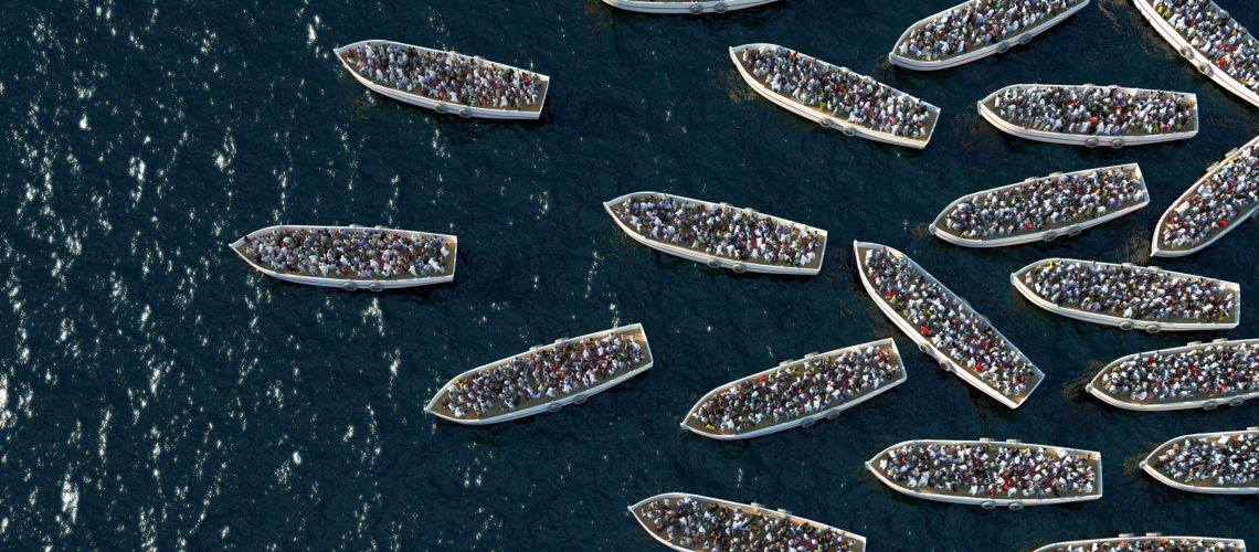 Refugees,Boat,Floating,On,The,Sea